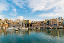 View Of Heraklion City Old Port And Buildings Clear Sky Calm Blue Water. Calm Day In Summer
