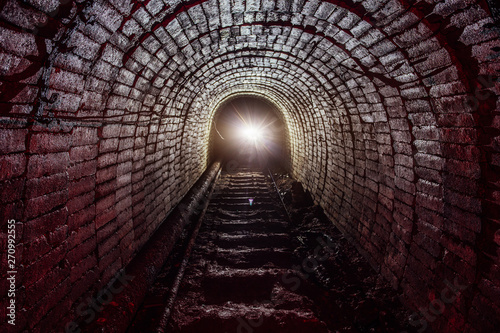Papiers peints Tunnel Dark dirty abandoned uranium mine with rusty remnants of railway