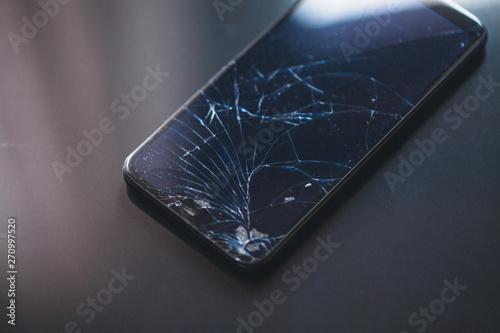 Tela Smartphone with broken touchscreen on black desktop