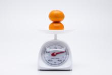 Healthy Mandarin Oranges On Balance Scale
