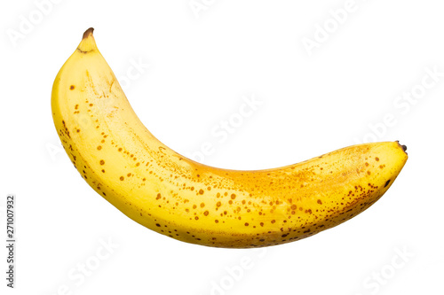 Valokuva  Banana overripe yellow with specks on a white background, isolate close-up Delic