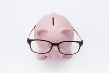 Pink Piggy Bank With Glasses Isolated