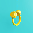 Yellow headphone with pastel blue background. 3d rendering
