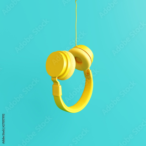 Fotografie, Obraz Yellow headphone with pastel blue background. 3d rendering