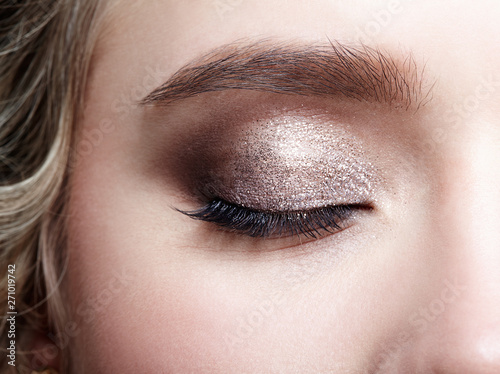 Obraz na plátne Closeup macro shot of closed human woman eye.