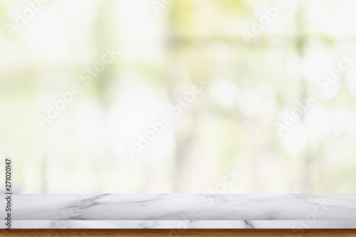 Obraz Empty marble table with blur living room interior background. - fototapety do salonu