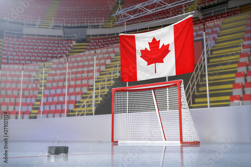Flag of Canada in hockey arena with puck and net