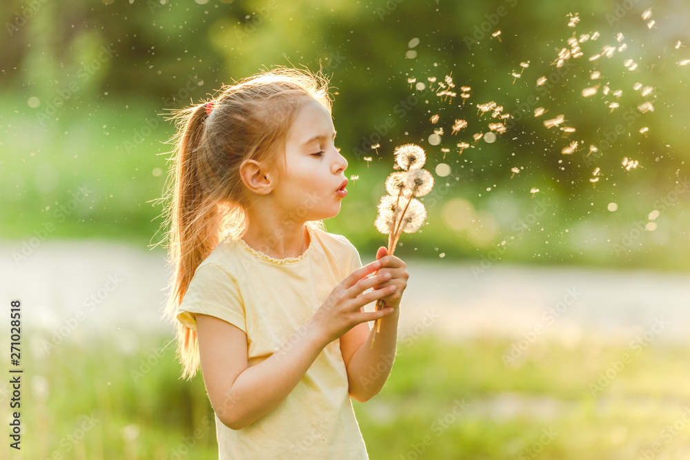 Fototapety, obrazy: Girl blowing at dandelions