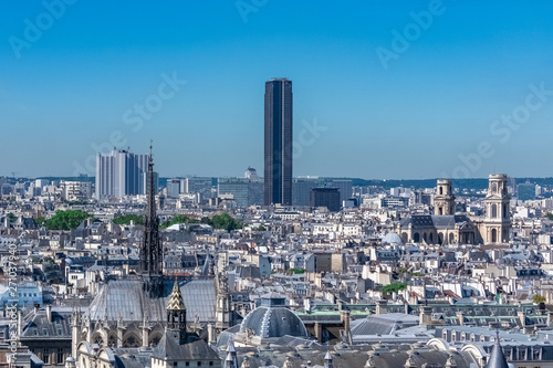 Poster Paris Paris, panorama of the city, with the Sainte-Chapelle, the Conciergerie, the Saint-Sulpice church, and the Montparnasse tower, in background