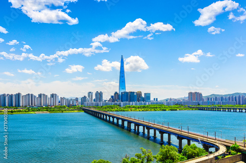 Skyline of Subway and Han gang River. Aerial view cityscape of Seoul, South Korea. Aerial Viewpoint Lotte tower. Beautiful clouds