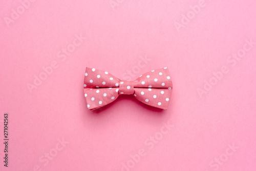 Obraz Bow-tie with polka dot on pink background - fototapety do salonu