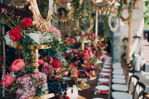Obraz na plátně Wedding table flowers with fruits and berries decor in red white pink green colors