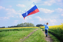 Little Boy With Flag Of Russia.