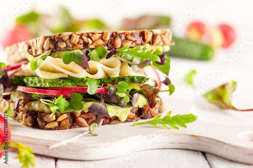 fototapeta na szkło Fresh vegetarian sandwich with cheese and veggies.