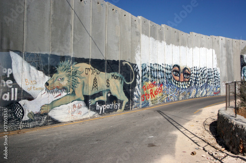 Activist graffiti adorns the Israeli separation wall in the West Bank town of Be Canvas