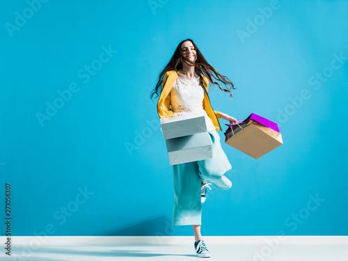 Fototapeta Cheerful young woman enjoying shopping obraz