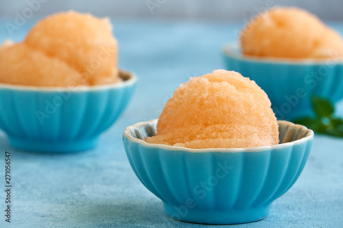 Leinwand Poster Homemade melon, apricot or peach ice cream , sorbet in bowl with  mint leaves