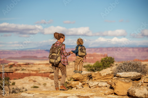 Fototapeta  Hiker with boy in Canyonlands National park, needles in the sky, in Utah, USA