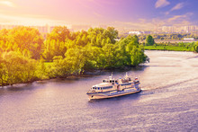 Aerial View Of A Small Cruise Ship Floating On The River On Background Of Purple Sunset Sky