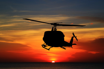 silhouette  the helicopter ...