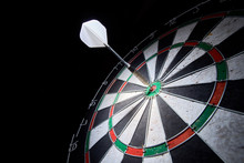 Darts Board On A Black Backgro...