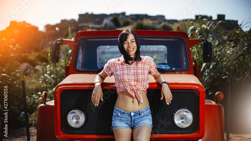 Tela  A beautiful woman on the farm with her old pickup truck