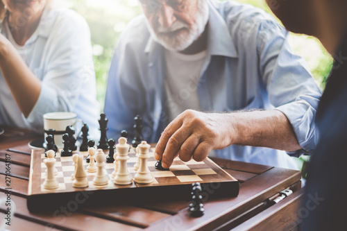 Senior old man playing chess game on chess board for strategy and planning conce Fototapete