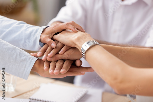 Fototapety, obrazy: Close up view diverse business people putting stacked hands together