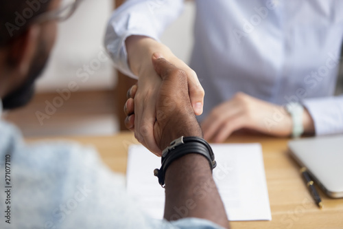 Photo sur Toile Les Textures Close up view handshaking hands after successful interview and negotiation