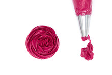Squeeze The Cake Decorating Cream Into Red Roses On A White Background.