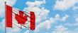 Leinwandbild Motiv Canada flag waving in the wind against white cloudy blue sky. Diplomacy concept, international relations.