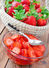Fresh Strawberries Bowl On Wooden Table