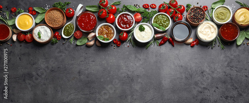 Fototapeta Flat lay composition with different sauces and space for text on gray background obraz