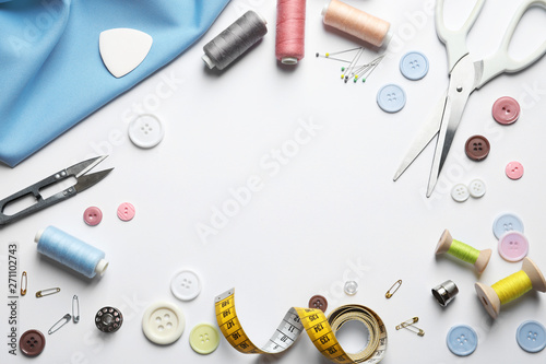 Flat lay composition with scissors and sewing supplies on white background Wallpaper Mural
