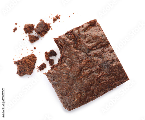 Fotografía  Piece of fresh brownie on white background, top view