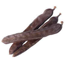 Heap Of Carob Isolated On Whit...