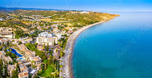 Pissouri. Cyprus Republic. Pissouri beach in a sunny day panorama from a drone. Residential settlements on the Mediterranean sea coast. The picturesque blue bay. The Pissouri resort. Travel to Cyprus.