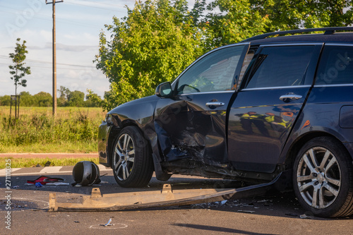 fototapeta na lodówkę Car destroyed as a result of a collision with a motorcycle at the crossroads