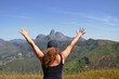 midle age woman on the top of a montain. Concept of success, freedom, joy, self estime, adventure