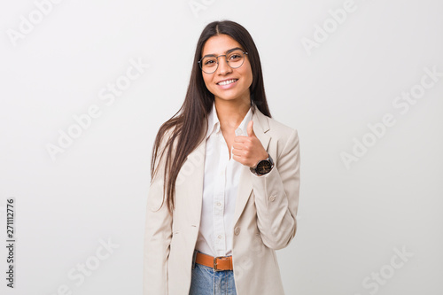 Fototapeta Young business arab woman isolated against a white background smiling and raising thumb up obraz