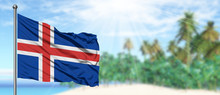 Waving Iceland Flag In The Sunny Blue Sky With Summer Beach Background. Vacation Theme, Holiday Concept.