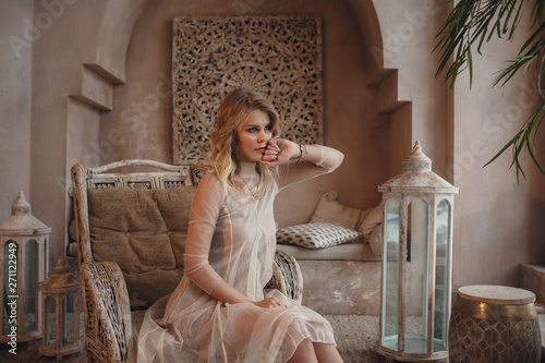 Canvas Prints Morocco Beautiful sexy woman blonde hair east style arabic morocco furniture glamour model pose fashion clothes