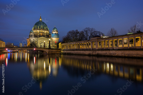 Fototapety, obrazy: Beautiful view of the illuminated Berliner Dom (Berlin Cathedral) and colonnade on the Museum Island and reflections on the Spree River in Berlin, Germany, at dusk.