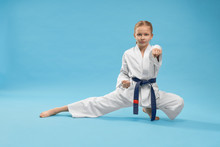 Karate Girl Standing In Stance And Training Punching.