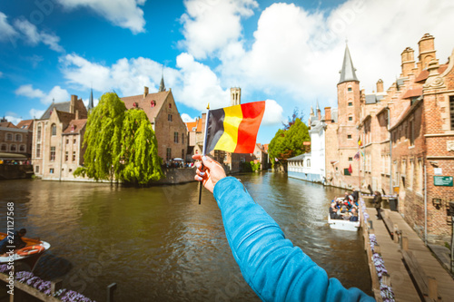 Flag of Belgium against the background of attractions in Bruges, Belgium Canvas Print