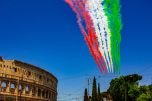 Rome, Italy, 02 / June / 2019. For The Feast Of The Republic, The Tricolor Arrows (representing The Italian Flag) Fly Over The Colosseum And The Imperial Forums.