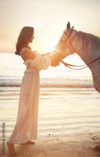 Photo sur Toile Artiste KB Beautiful, young woman with a calm horse