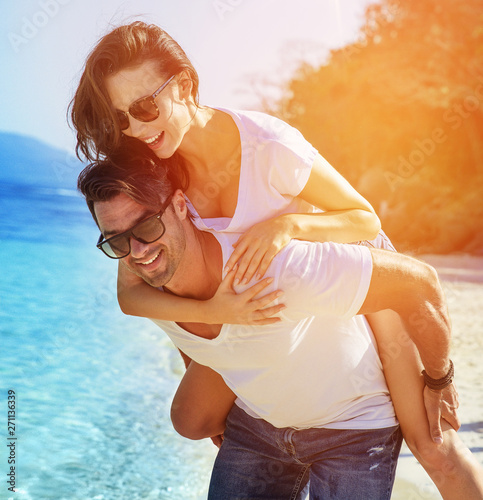Tuinposter Artist KB Young, attractive couple relaxing on a tropical beach