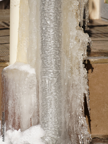 Valokuva  Ice and icicles on a drainpipe
