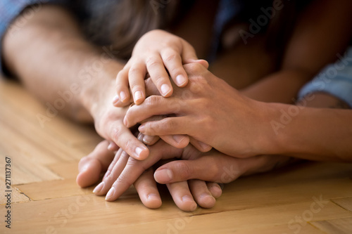 Foto auf Leinwand Texturen Close up of loving family stack hands showing unity